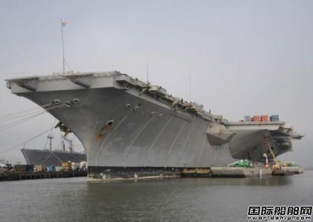 世界首艘核动力航母拖往船厂拆解