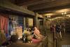 图为方舟内部陈列,展示着诺亚一家和带着动物的箱子。